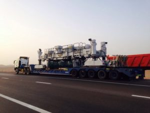 heavy lift industrial cargo is being loaded onto a truck of dubai company