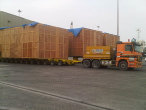 heavy cargo containers loading on truck by a shipping company