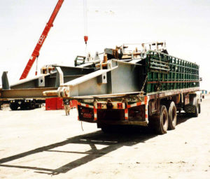 cargo trucks are transporting industrial equipment from qatar to oman through land freight