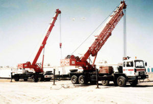 heavy and latest technology cranes loading the temperature controlled containers to be transferred to the clients.