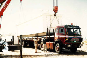 Equipped containers are loaded on trailers under the supervision of trained staff of our company.