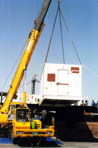 Edible items are stored in temperature controlled container and lifted by the crane to load on a cargo truck.