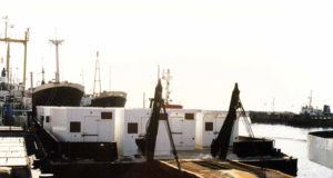 the equipment holding containers are ready to load on ship to deliver through sea freight by ADSO.