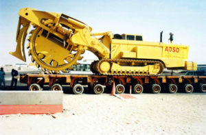 the heavy equipment is loaded on trailer by the cargo company after a long inspection on its way to Saudia.