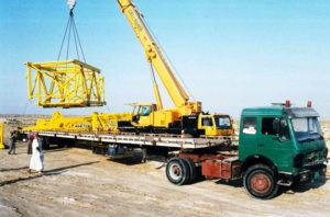 cargo lashing belts are loading on trailers via heavy cranes