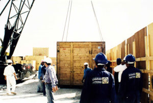 after unloading cargo container stored by outdoor storage service facility by the staff members of the cargo company.