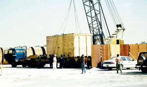 A cargo container while loading on a truck through Land freight ready to go from dubai to Qatar.
