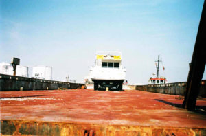 cargo truck leaving the port for delivering industrial equipment